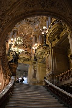 "Looking up to the main landing of the grand staircase at the Paris Opera House. The statues are meant to be holding ""bouquets of light,"" as the electric lights were new when the theater first opened."