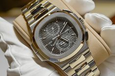 Patek Philippe Nautilus Travel Time Chronograph - Baselworld 2014  http://www.luxify.de/patek-philippe-nautilus-travel-time-chronograph-5990-1a-001/