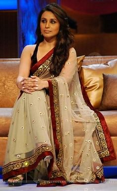 So pretty! Love the black blouse with this sari