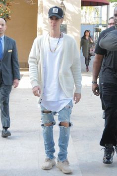Justin Bieber wearing New Era Xxlarge Patch D-Frame Trucker Hat, Adidas Yeezy Boost 350 Oxford Tan, Fear of God Selvedge Denim Vintage Indigo Jeans, Onemeth Thermal Long Shirt and 424 x Black Dakini Cuban Link with Spinel Beads