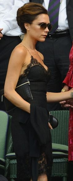 Victoria Beckham in LV black lace dress Fall 2013