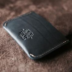 Proudly made in the USA. Custom 1 inch Texas Mason Concho on a Black Harness Leather Trifold Wallet