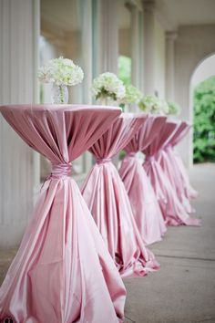 love the way these linens are tied for bistro tables. Cocktail hour. @Brittany Horton Horton Horton McPeek I want the linens pale pink and maybe we could incorporate the pearls filled vase pic for this centerpiece instead!? :)