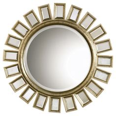 Sunburst-inspired mirror.Product: Wall mirror    Construction Material: Wood and mirrored glass    Color: Distressed gold leaf       Features:   Light antiquingAccented by several individual mirrors   Beveled edges         Dimensions: 34 Diameter