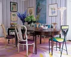 In Amy Fine Collins' Manhattan dining room, a sketch of Balenciaga couture, a 1940s cover illustration for Vogue, and an oil on canvas by Marcel Vertès are displayed; the whitewashed chairs are by Syrie Maugham, and the Palm chairs by Mario Villa are upholstered in Gene Meyer scarves.    - ELLEDecor.com