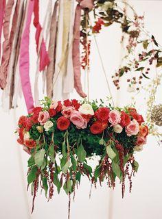 #hanging arrangement #florals  #reds #pink #wedding #flowers Photography: Brett Heidebrecht - www.brettheidebrecht.com  Read More: http://www.stylemepretty.com/2015/06/02/colorful-boho-glam-texas-hill-country-wedding/