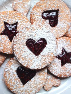 Finished Linzer Tart Cookies sprinkled with powdered sugar #BakeitForward / @arrowheadmills