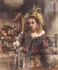 madame thenardier- here you can see design more of pre-1800s bodice with removable sleeves (tie on)... one missing.  She is dressed in layers as cold out. likely long sleeve chemise, bodice (some green under), skirt.