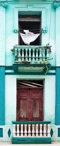 Vertical panoramic view of the front of an old building in Santa Clara, Cuba