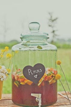 Pimms and lemonade cocktail in a vintage glass drinks dispenser. For more wedding inspiration via www.vintageweddingfair.co.uk