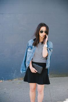 Crystalin Marie dresses up her Gap denim jacket with a feminine skirt and clutch.
