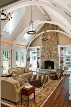 Traditional Living Room with Exposed beam, French doors, High ceiling, Window seat, Hardwood floors, Built-in bookshelf
