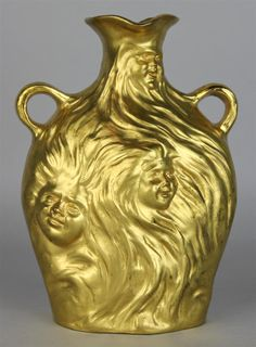 "ART NOUVEAU STYLE GILT VASE IMPRESSED ""G. COUDRAY"" impressed ""G. Coudray"" near base for Georges Charles Coudray (French, ca. 1883-1932) with seven faces of men and women throughout body of gilt metal handled vase."