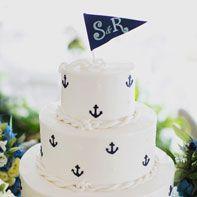 Nautical Wedding Cake with Anchors.  Photo by Christina Szczupak