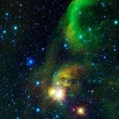 This colorful image from NASA's WISE (Wide-field Infrared Survey Explorer) is a view of an area of the sky over 12 times the size of the full Moon on the border of the constellations Sagittarius and Corona Australis. Two types of star clusters are visible in the image.