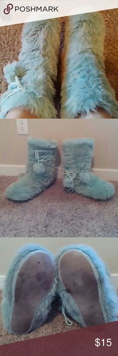 Victoria's secret boots Very nice fuzzy boots, kind of look like the ugg momma boots. Light blue, these wore well worn. but still very comfy and wearable, have a little bit of damage to heel area as seen in pic.  Will probably need a wash in a gentle cycle. Condition reflects price The ties can be moved around to any position you like.  Any questions please ask before you decide to buy. Thank you! Victoria's Secret Shoes