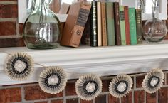 Phone book paper pinwheel banner via Thrift My House: My 2015 Simple Winter Mantel