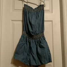Adorable light denim romper This romper is very comfortable and stylish. Elastic around the top and waist, with pockets. Other