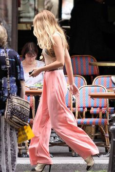 Blake Lively in a pair of perfectly pink silk trousers.