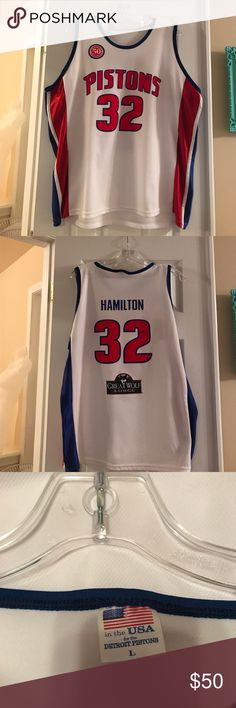 Pistons Jersey Pistons Jersey from when Hamilton was on the team!! #32!! 2 Small snags on the front of the jersey, as noted in picture!! Circled one is very small Other