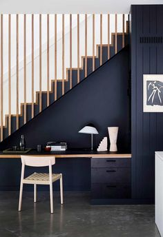 The blackbutt timber staircase with battens is paired with a clever in-built study nook underneath. The study area is painted black, creating visual integration. The concrete polished floor adds a soft contrast. Staircase Storage, Stair Storage, Timber Staircase, Black Staircase, Concrete Staircase, Escalier Design, Home Stairs Design, Study Nook, House Stairs