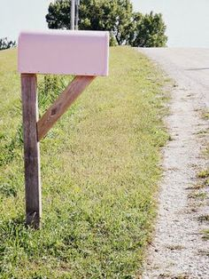 Spray painted pink mail box off what looks like a country road <- love the simple pop of color, maybe we could find a perfect peach or lavender?