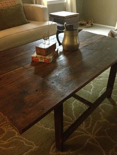 Step-by-step instructions on how to refinish an old wood table using Tung Oil Finish - cheap and easy weekend project - DIY coffee table.