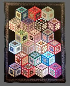 Tumbling blocks quilt with stars by Bernice Enyeart. Photo by Skybridge Studios Tumbling Blocks Quilt, Quilt Blocks, 3d Quilts, Star Quilts, Quilting Projects, Quilting Designs, Optical Illusion Quilts, Optical Illusions, Geometric Quilt