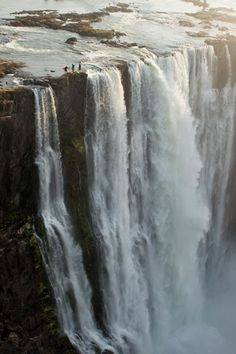 Victoria Falls - The Largest Waterfall in the World. The Victoria Falls or Mosi-oa-Tunya is a waterfall located in southern Africa on the Zambezi River between the countries of Zambia and Zimbabwe Rhodesia. Adventure Awaits, Adventure Travel, Places To Travel, Places To See, Travel Destinations, Africa Destinations, Tourist Places, Vacation Travel, Chutes Victoria
