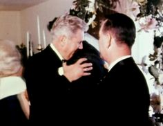 Vernon hugging Elvis at his wedding.