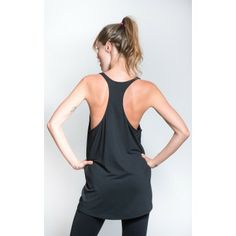 Sportsvest with draped look in black and 3/4 length cut and racer-back design worn with logo print leggings #sportswear #activewear #leggings #sportsvest #yoga #pilates #workout #fitness #fashion #swallow