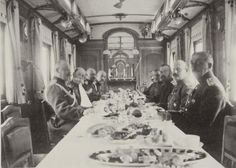 Nicholas Alexandrovich Romanov (Tsar Nicholas II) hosting a dinner with his generals on the imperial train.