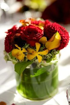 Reds, yellows and greens for the table centerpieces.