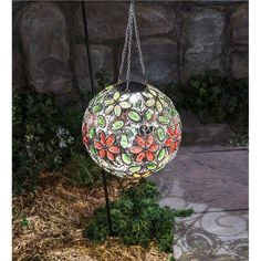 The Hanging Solar Flower Jewel Ball Gazing Globe is a dazzling accent that will become the crown jewel of your yard and garden. The improved design features a durable powder-coated, rust-resistant, matte-finish metal for long-lasting beauty. An integrated solar panel powers the interior light. Lanterns Decor, Hanging Lanterns, Garden Spinners, Lawn Ornaments, Crackle Glass, Garden Signs, Lawn And Garden, Garden Art, Solar Lights