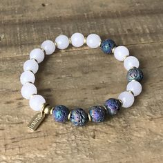 Essential oil diffusing rose quartz and lava beads bracelet. Apply a drop of your favorite essential oil on your bracelet, and carry the scent with you!
