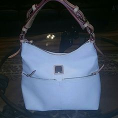 White and tan Dooney & Bourke hobo Very clean never used hobo. Smoke free, leather trim, cotton texture cover. Leather key keeper. Very thick leather shoulder strap Dooney & Bourke Bags Hobos