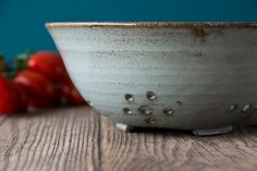 I made this beautiful colander on my pottery wheel from a white speckled clay, trimmed with an attractive base. I then coated the surface with a lovely rustic teal glaze.  It holds approximately 3 cups. Works great for berries, cherry tomatoes, olives, grapes... anything you want to rinse and strain.  This is a handy and decorative kitchen item. I have one on my counter and use it several times daily.  Measurements: approx: 3 inches high x 7 inches diameter. approx: 7.5 cm. high x 17 cm…