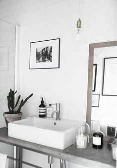 white walls, sink, exposed plumbing, mirror