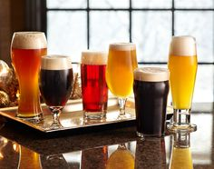 The right glass for the right craft #beer—from left: Wheat pilsner, Belgian flute for lambic beer, kolsch beer stange, stemmed tulip for ales, classic pub pint glass and pokal pilsner for lagers.