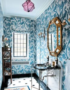 We're loving the use of bold wallpaper in this bathroom