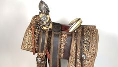 """Pancho Villa saddle, circa 1915 of 17: Courtesy Enrique Guerra, San Vicente Ranch, Linn, Texas. When an uprising broke out in 1910, Francisco """"Pancho"""" Villa quickly became one of the most well-known military leaders of the Mexican Revolution. In 1913, Villa signed a contract with Hollywood's Mutual Film Company to film many of his battles, riding his horse on an embossed, highly decorated saddle with silver trim."""