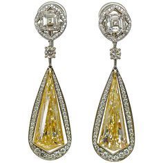 Unique! Fancy Yellow Diamond Earring   From a unique collection of vintage drop earrings at https://www.1stdibs.com/jewelry/earrings/drop-earrings/