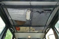 rv-ceiling-cargo-net a cargo net not for a truck bed or trunk, but to fasten to the ceiling over bunks or the couch in living area. Initially it sounds like an eyesore, but if you purchase high quality cargo netting, it should allow for enough stretch to retract out of sight when not in use. More