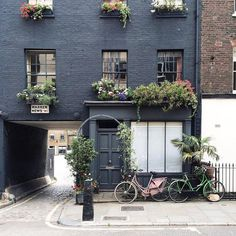 A charcoal-washed brick abode of the most spirited details captures the essence of this lovely London block