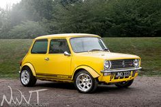 Yellow Classic Mini Clubman 1275 GT by NWVT.co.uk, via Flickr
