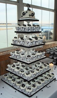 Black & White Damask cupcake wrappers with daisy flowers on tower built from crystal cake pedestals.   Daisy1 2011