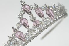This pretty little tiara measures 2 inches or 5 cm at its highest peak and is adorned with 57 crystals to make it sparkle. This tiara would look