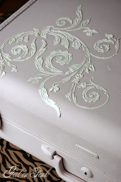 VP Antico pushed through an Artisan Enhancements stencil to create a raised relief on a vintage suitcase.