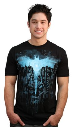 ARISE T-shirt by silentOp from Design By Humans. Director/Writer/Producer Christopher Nolan and Producer Emma Thomas picked Arise as the 3rd place t-shirt design contest winner. This Dark Knight Rises black tee will grab attention with the bright blue Batman logo and mask that shines through the city of Gotham.  This exclusive shirt is a sure addition for any Dark Knight Rises fan. (For $22)