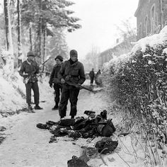 Allied troops and German dead Battle of the Bulge the final major German offensive of WWII